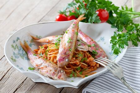 mullet: Plate of spaghetti with red mullet sauce, traditional plate of the Italian cuisine. Stock Photo