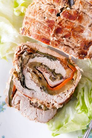 filled roll: Turkey roll filled with grilled vegetables, ham and cheese, closeup shot, high angle view. Stock Photo