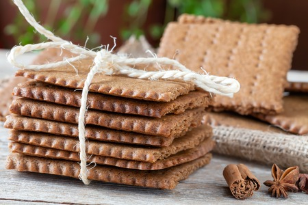 bounded: Swedish spiced biscuits in stack, bounded with kitchen string, closeup view.