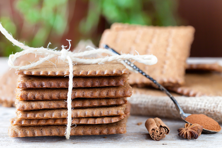 bounded: Homemade spiced biscuits in stack, bounded with kitchen string. Stock Photo