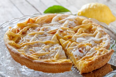 Grandmas cake, typical cake from Tuscany, Italy, made with shortbread pastry, ricotta cheese and pine nuts.