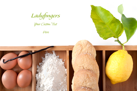 high angle: Ladyfingers or Savoiardi cookies ingredients. Savoiardi are traditional Italian biscuits. High angle shot with copy space. Stock Photo