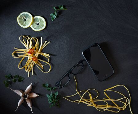 customizable: Smart cooking background with food ingredients, smartphone with customizable copy space and eyeglasses.