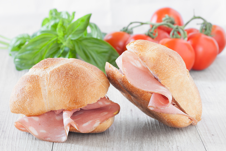 Finger food, buns filled with mortadella, typical Italian cold cut.