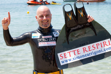 establishes: SANTA MARINELLA, LAZIO, ITALY - JUNE 8, 2016: Simone Arrigoni, world champion of apnea, establishes a new world record swimming as a dolphin to over 1000 meters in 23 minutes and 30 seconds, breathing only for 95 seconds. Editorial