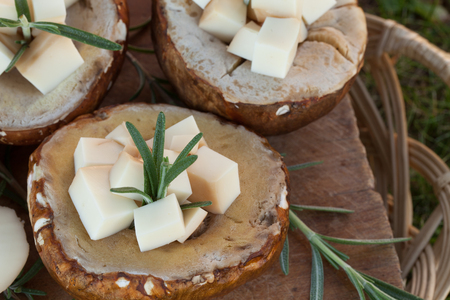 scamorza cheese: Porcini mushrooms filled with smoked scamorza cheese and rosemary prepared for the grill.