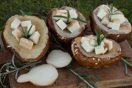 scamorza cheese: Porcini mushrooms filled with scamorza cheese and rosemary.