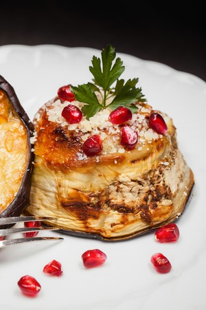 Eggplant zuccotto made with scamorza cheese, decorated with parsley and pomegranate. Typical dish of Italian cuisine.