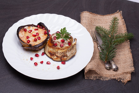 Eggplant zuccotto, italian traditional dish made of eggplant, scamorza cheese and anchovies. Decorated for Christmas. Stock Photo