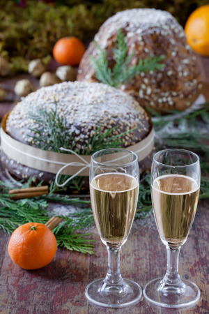 cin: Glasses of champagne and panettone, italian traditional way to celebrate The New Years Eve.