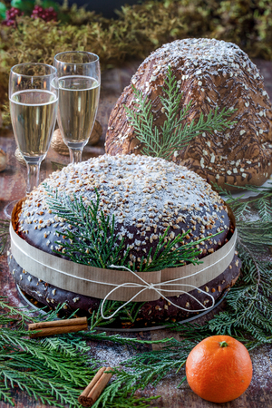 cin: Christmas table with panettone, pandoro and champagne glasses.