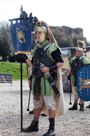 reenactment: ROME, ITALY - APRIL 19, 2015: Birth of Rome festival - Actors dressed as ancient Roman Praetorian soldiers attend a parade to commemorate the 2,768th anniversary of the founding of Rome.