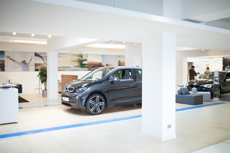 i3: ROME, ITALY - MARCH 10, 2014: The new five-door urban electric car BMW I3 inside dealer showroom. The i3 is BMWs first zero emissions mass-produced vehicle due to its electric powertrain.