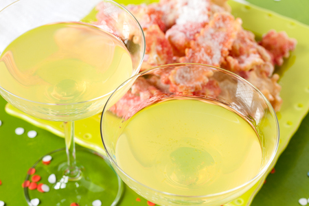 chiacchiere: Limoncello, lemon liqueur, served with fritters, typical Italian food and drink in the carnival period.