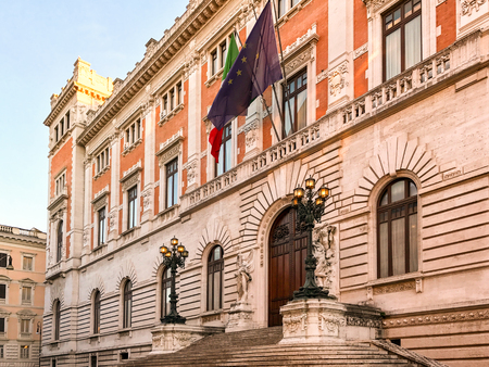 derives: ROME, ITALY - DECEMBER 28, 2016: View of Palazzo Montecitorio where is the seat of the Italian Chamber of Deputies. Was originally designed by Gian Lorenzo Bernini for the young Cardinal Ludovico Ludovisi and it�s name derives from the slight hill  Editorial