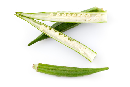 sectioned: Okra pods, whole and sectioned on white background.
