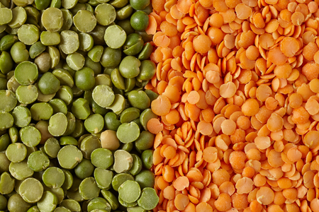 Green split peas and red lentils, flat lay background.