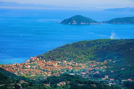 livorno: View above Marciana Marina and the Mediterranean Sea at Elba Island, Tuscan Archipelago, Italy. Stock Photo