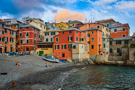 BOCCADASSE, GENOA, ITALY - OCTOBER 5, 2009: People enjoying the sunset on the small beach of Boccadasse,  fishermen district in the suburbs of Genoa.