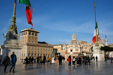 ROME, ITALY - JANUARY 27, 2008: People visiting Vittoriano in Piazza Venezia. The Altare Della Patria  is a monument built in honor of Victor Emmanuel, the first king of a unified Italy.