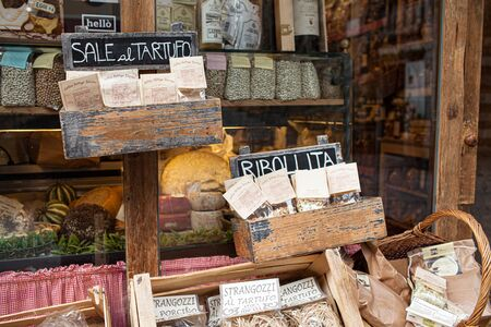 AREZZO, TUSCANY, ITALY - JANUARY 10, 2016: Typical Italian products displayed on the storefront of Antica Bottega Toscana, one of the oldest shops in the city of Arezzo selling most typical food products of Tuscany.