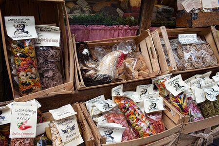 AREZZO, TUSCANY, ITALY - JANUARY 10, 2016: Typical Italian artisanal pasta, spices and cookies, displayed on the storefront of Antica Bottega Toscana, one of the oldest shops in the city of Arezzo selling most typical food products of Tuscany.
