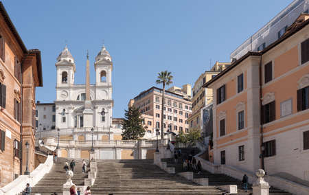 Rome, Italy - February 25 2021: A view of Trinità dei Monti and Spanish Steps during the emergency with few people passing by