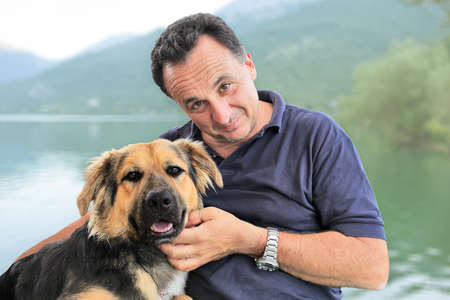 Portrait of a man together with his adopted dog Stok Fotoğraf