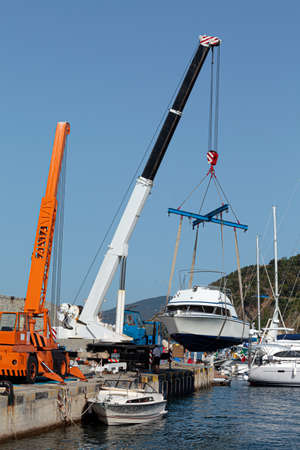 Boat launch operations with marina crane
