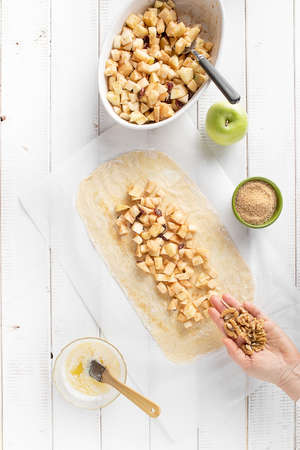 Adding nuts in the apple strudel filling