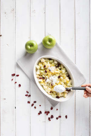 Adding maize flour in the filling for the apple strudel consisting of apples, raisins and grated lemon peel Stok Fotoğraf