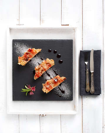 Slices of apple strudel on piece of slate photographed from above