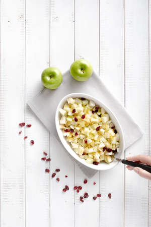 Basic filling for the apple strudel consisting of apples, raisins and grated lemon peel