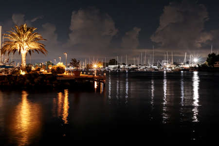 Marina by night - Porto Romano at Fiumicino on the Tiber river in Italy