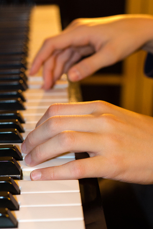 Young piano players hands photo