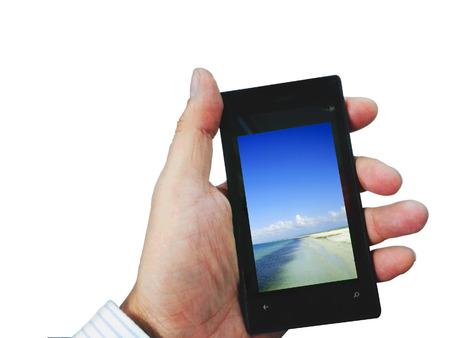 grasping: Man hand grasping Smartphonee Stock Photo
