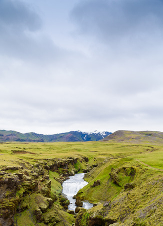 skogafoss waterfall: View of an upper waterfall leading to the Skogafoss waterfall in Iceland