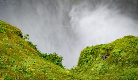 skogafoss waterfall: Misty hillside near the Skogafoss waterfall in Iceland Stock Photo