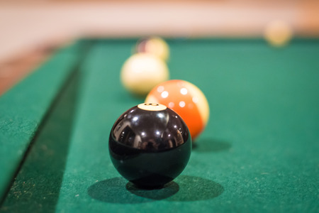 solids: A closup of several billiard balls, with the background balls out of focus Stock Photo