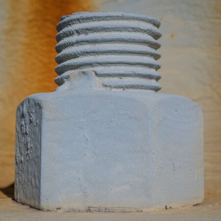 metal fastener: A very large nut & bolt supporting a large metal pole