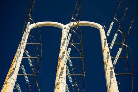 High voltage power lines and supporting poles