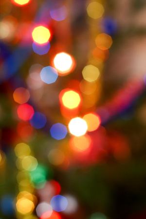 Bokeh effect on the colored lights on a Christmas tree Stock Photo