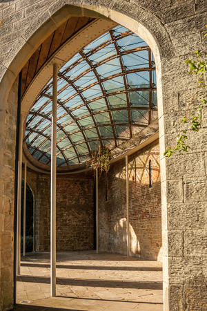 glass ceiling: The interior of a stone brick building with a patterned glass ceiling.