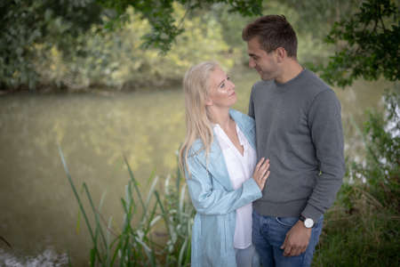 Couple Share An Intimate Moment Together Outdoors By A River