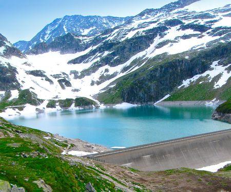 Dam on lake in Alps