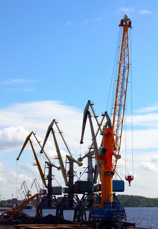 Few port cranes against the bay in Vyborg, Russia Stock Photo - 8051017