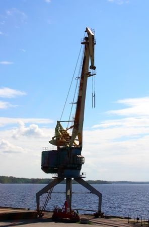 Port crane against the bay in Vyborg, Russia Stock Photo - 8050997