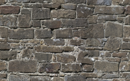 Seamless texture of old stone wall of fortress Stock Photo