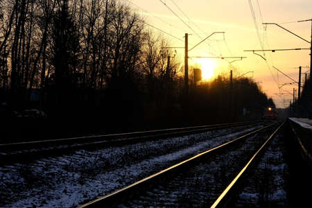 Railroad and train against the sunset lights
