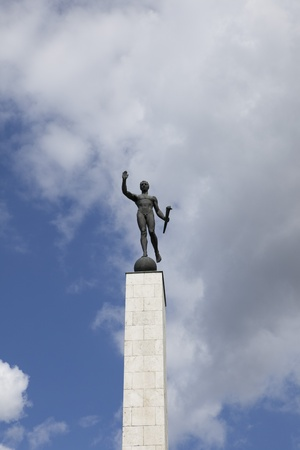 totalitarianism: statue of torch-bearers Stock Photo